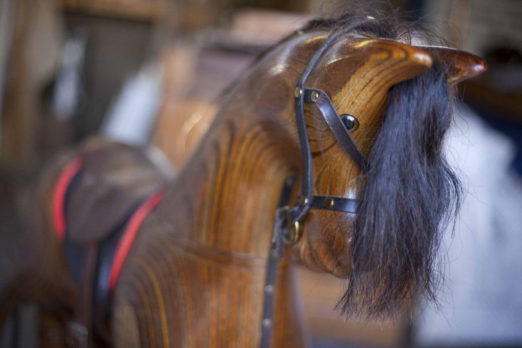 Close up of wooden rocking horse face