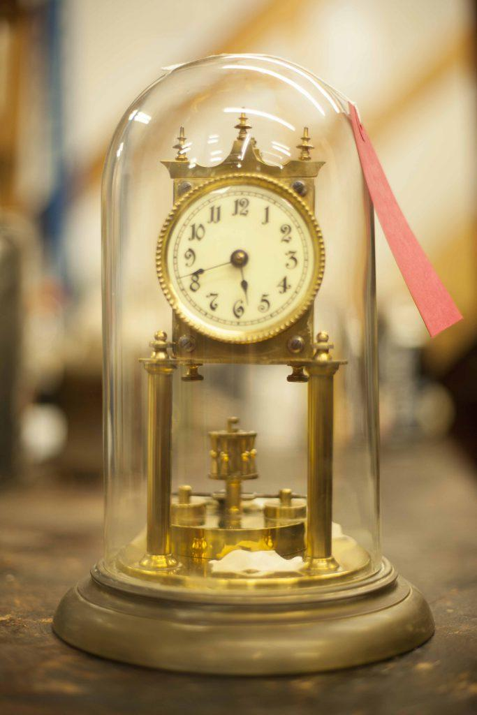 Antique clock under glass dome