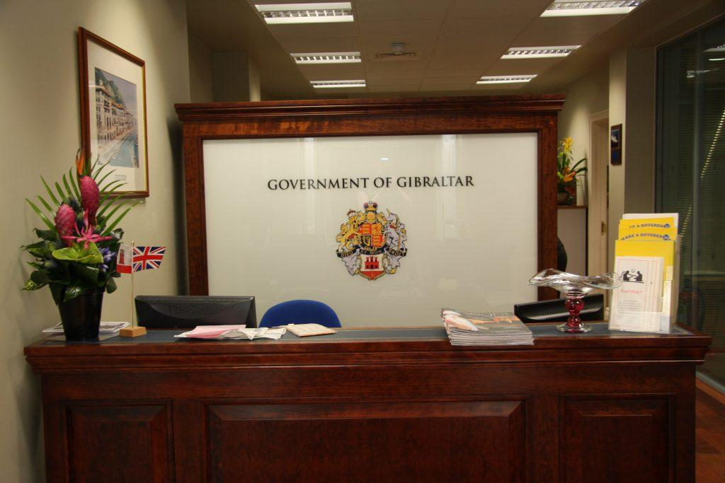 Government of Gilbraltar sign behind a front desk