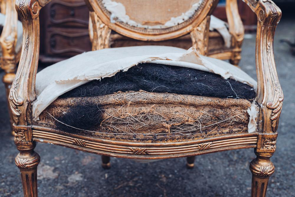 Worn and torn seating of antique chair