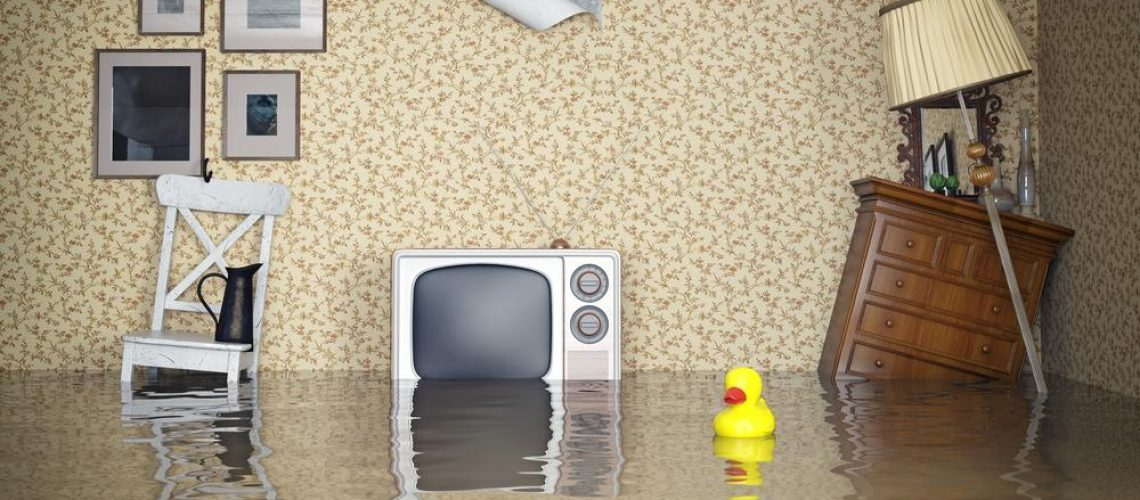 Living room furniture submerged in flood water